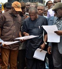 L-R: CR governor, Liyel Imoke, SA Projects, Bassey Oqua and Dep. Gov, Efiok Cobham, examine drawings during the ground breaking of the Ugep Polytechnic